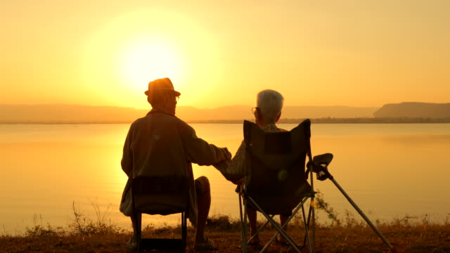 lake-sunset-couple-chairs